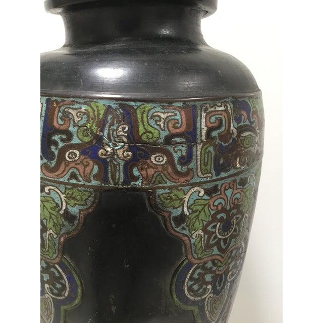 Fabulous antique Chinese cloisonné vase from the 19th century. The vase is patinated black, a lovely old rubbed ebony...