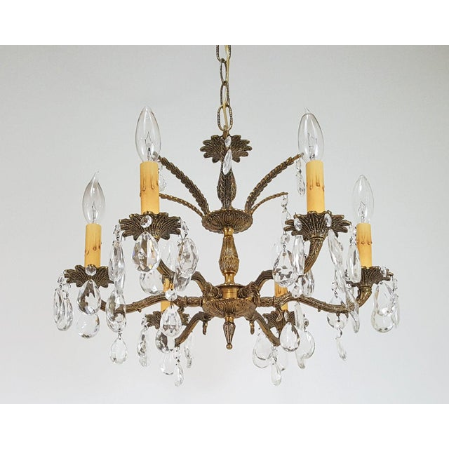 A 1940s solid brass and crystal teardrop chandelier with fancy brass chain and ornate brass canopy made in Spain excellent...