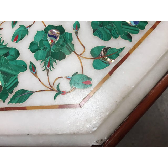 Exceptional example of a handcrafted marble Pietra Dura topped octagonal occasional tabletop on wooden base. Hand made by...