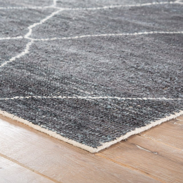 This modern hand-loomed rug enriches spaces with bold geometric patterning and a temptingly soft feel. Texture-rich and...