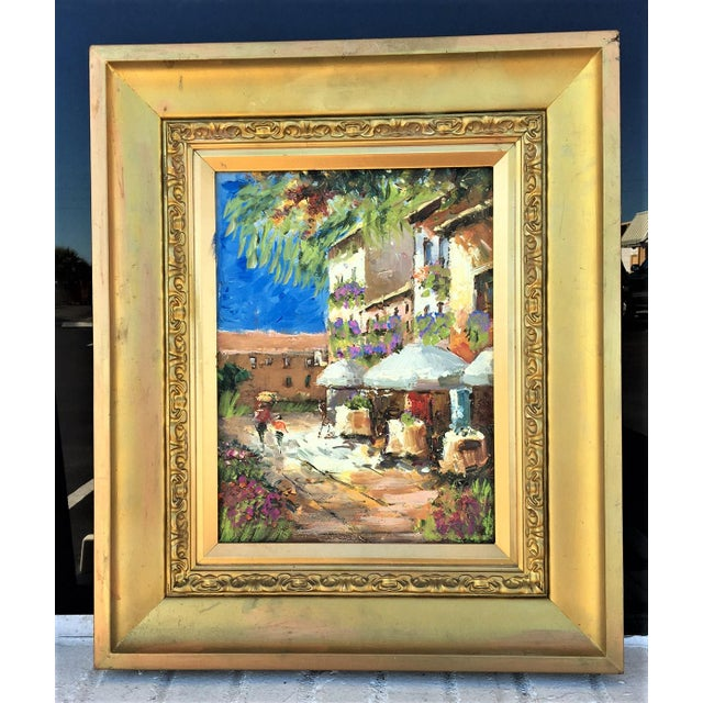 This colorful oil painting portrays an Italian café on a cheerful, sunny day. The artist used a heavy application of...