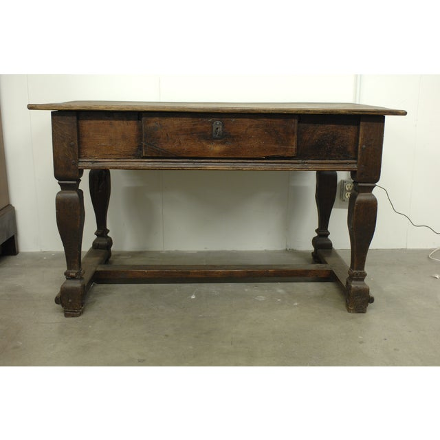 This large antique wooden desk is an incredibly special find. It features a  locking drawer - Antique Wood Desk With Lock And Hidden Drawers Chairish