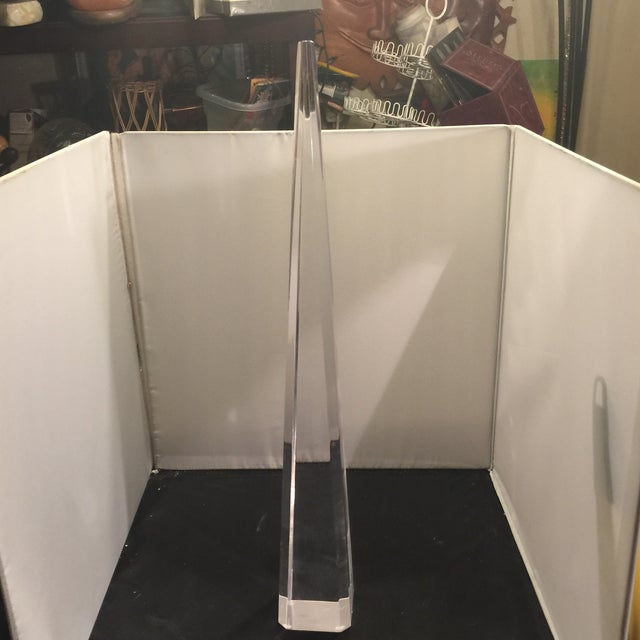 A tall lucite spike. A great accent for a dining room table.