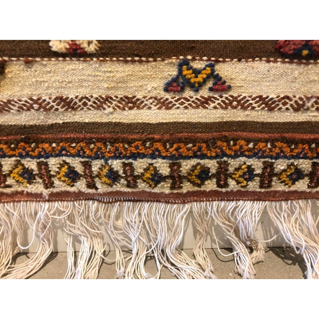 Vintage Moroccan high/low textured rug. Features a beautifully intricate hand-woven pattern. Colors include dark blue,...