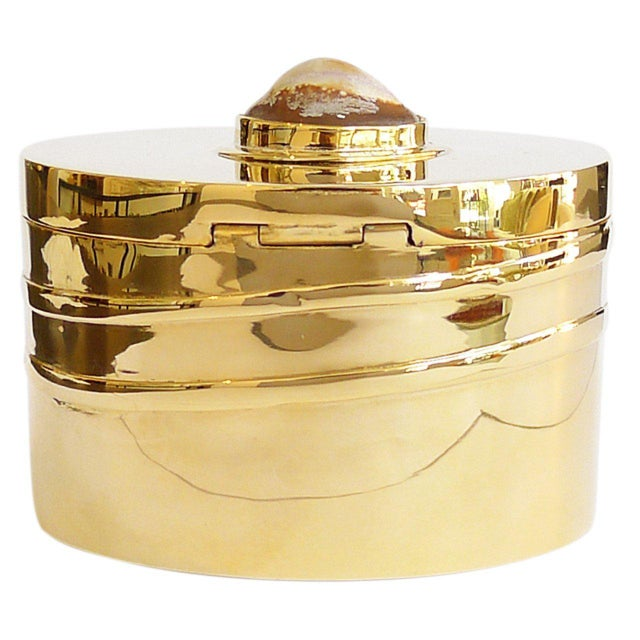 Gilded Modernist trinket box in an oval shape with shell detail on lid.