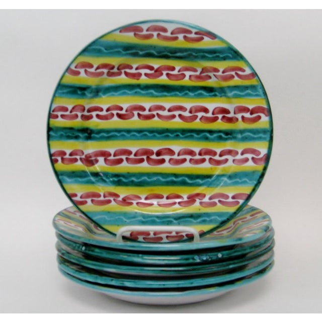 Set of 6 Italian glazed ceramic salad plates with hand-painted designs in teal, yellow and red. Hand signed on reverse....