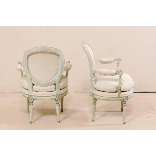 Pair of French Oval-Back Bergère Chairs With Delicately Carved Floral Motifs For Sale - Image 4 of 11