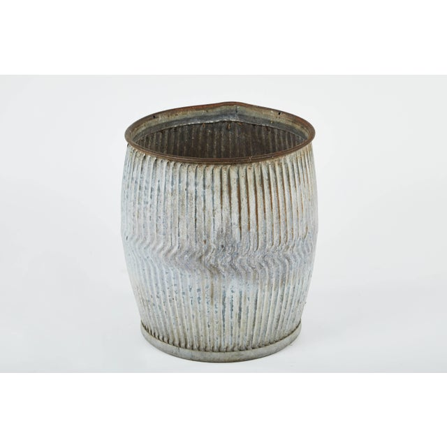Two early 20th century English zinc pots with zig zag motif, originally used as wool dollys. They make beautiful planters...