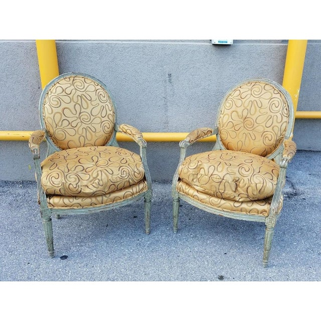 This is a pair of stunning 18th century French Louis XVI medallion chairs. The pieces feature a painted finish. They are...