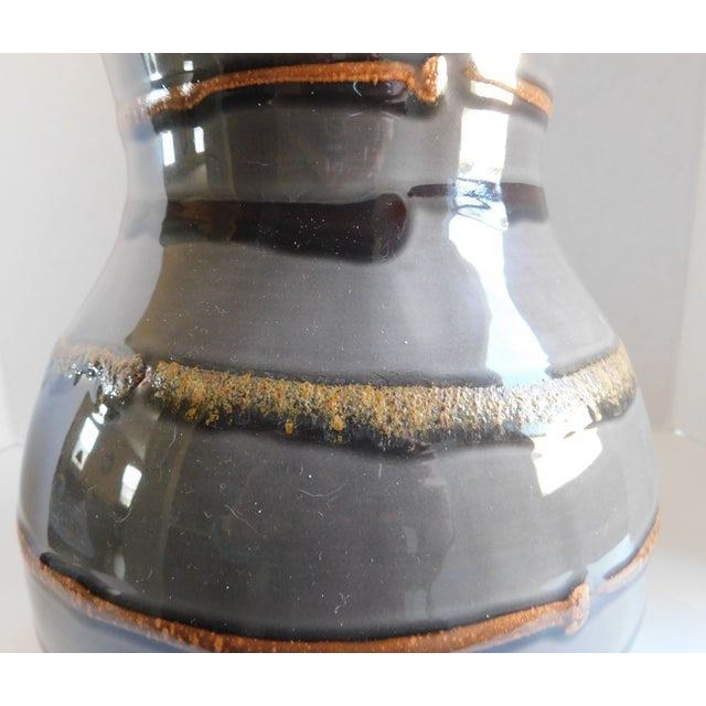 I love this fabulous rounded grey striped vintage vase. It has all of the right colors and style - rust, black, and tan...