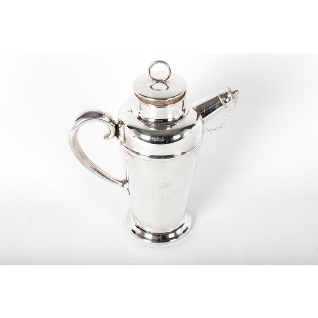 Vintage English silver plate cocktail shaker. This shaker would bring a great addition to any bar. The cocktail shaker...