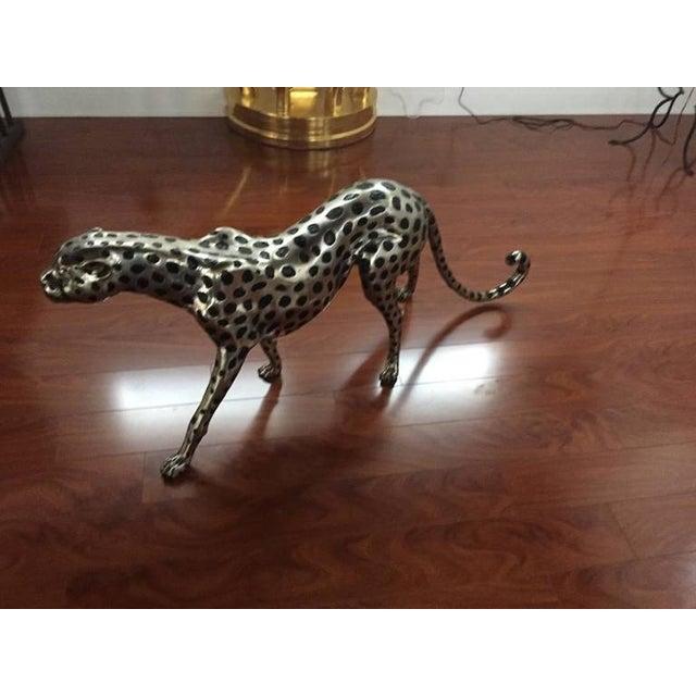 Stunning huge metal cheetah. Silver and black painted on metal cheetah.