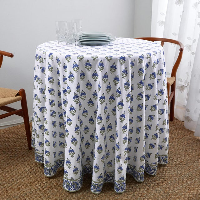 The Blossom design illustrates a traditional Indian flower motif set against a scrolling floral border for a beautiful...
