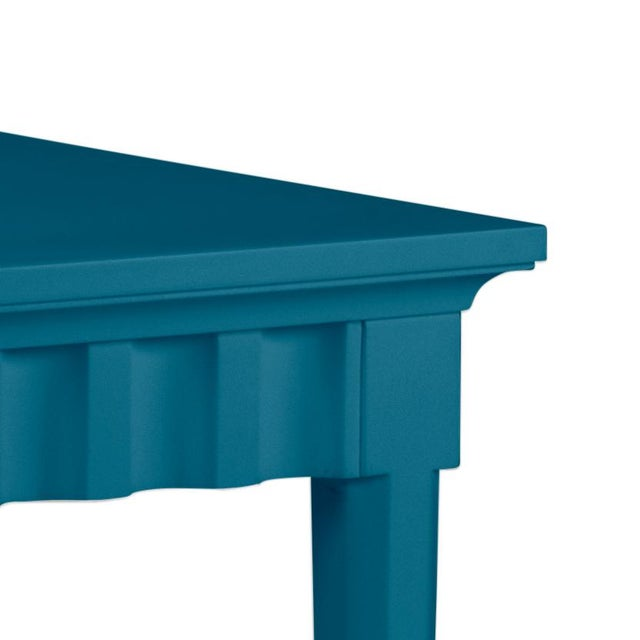 Scallop pattern design on console and finish is Benjamin Moore Blue Danube. Made of acacia wood.