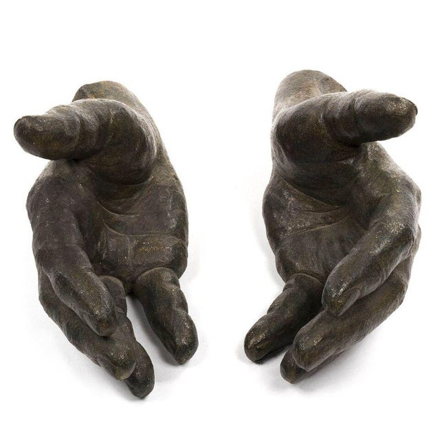Pair of ceramic hands with bronze finish by Clara Wine, 1974.