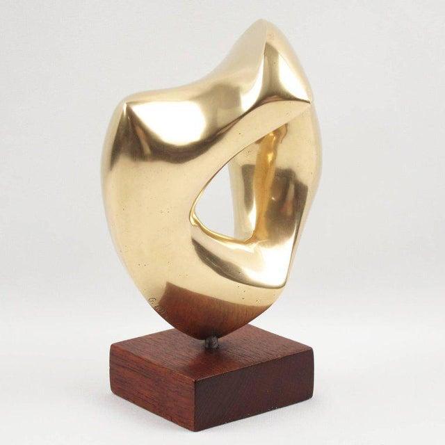 Lovely abstract bronze sculpture by G. Morleghem, Belgium, circa 1950s. Featuring an interesting organic free-form shape...