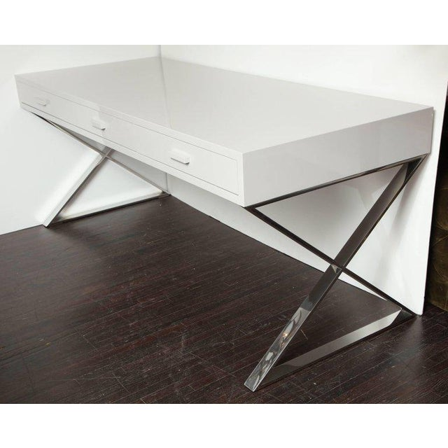 Custom oversized high gloss lacquer desk with mirrored stainless steel X band legs.
