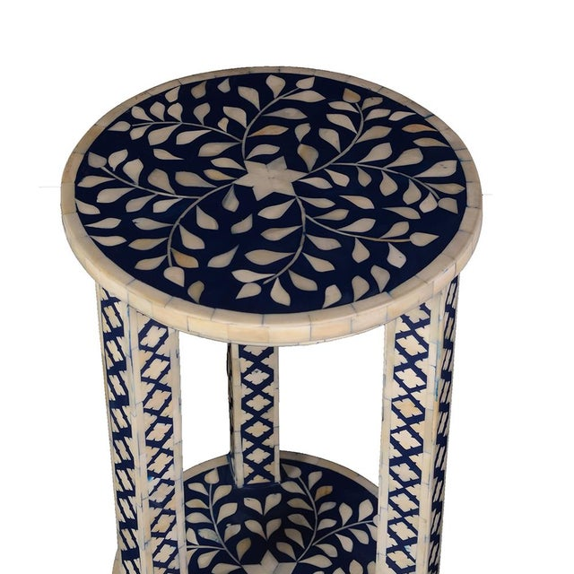 This double tiered Imperial Beauty round accent table, stands out in any room of the home. As beautiful as it is...