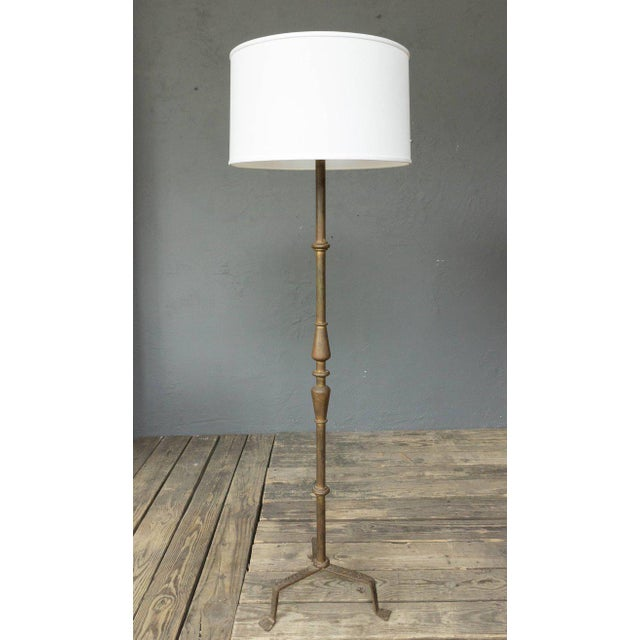 Handsome gilt iron floor lamp with turned parts and hammered iron detail. Spanish, circa 1950s. (Not sold with shade).