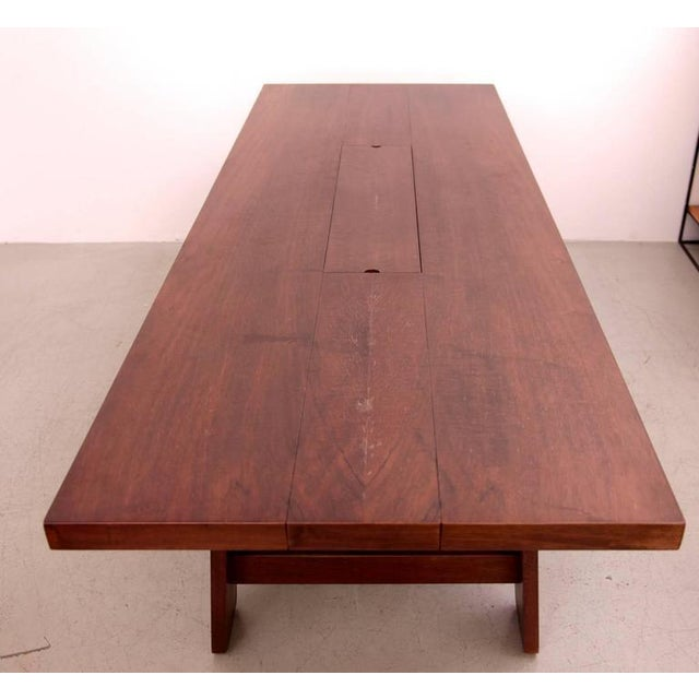 Stunning large mahogany dining table by Silvio Coppola, Bernini Italy, 1960s. Good vintage condition. The ceramic serving...