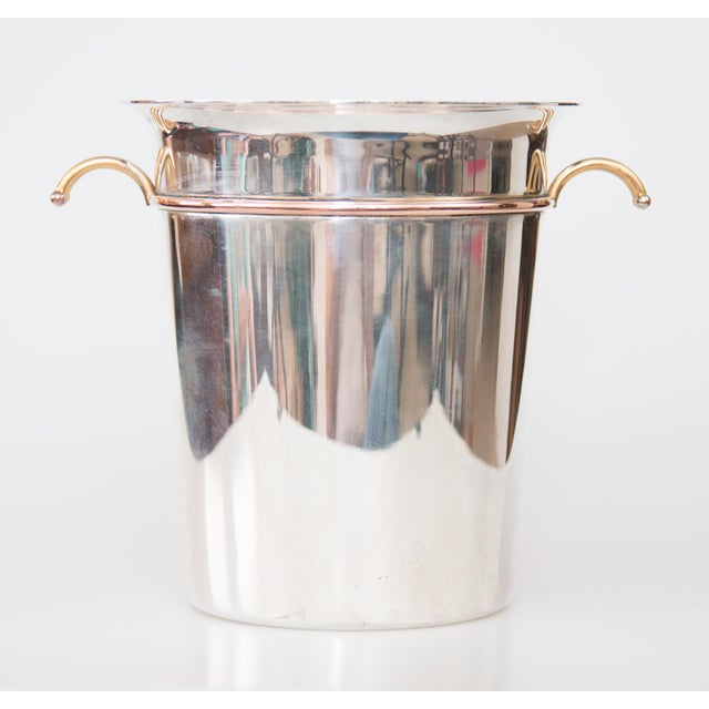 A fabulous early 20th-Century French Art Deco silver plated champagne bucket or wine cooler with brass handles. Signed on...