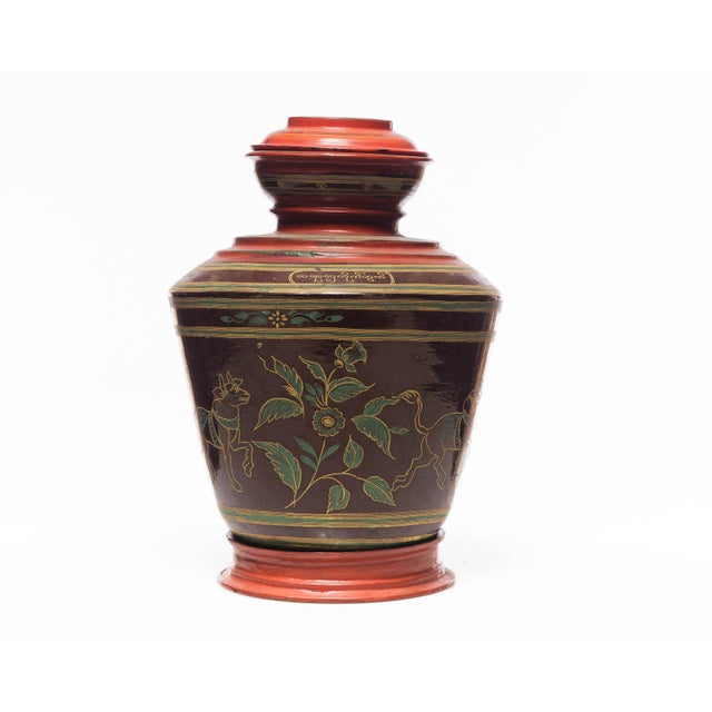 A enchanting 19th-century 3-part Burmese lacquerware ginger jar in traditional Burmese style on top with red interior. All...