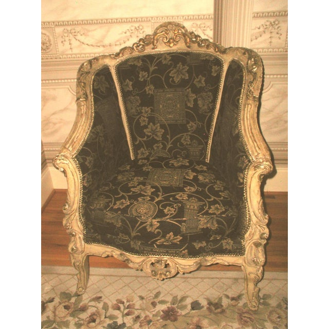 Pair of exceptional 18th century gesso painted French hand carved arm chairs. Painted in cream with gilt trim around all...