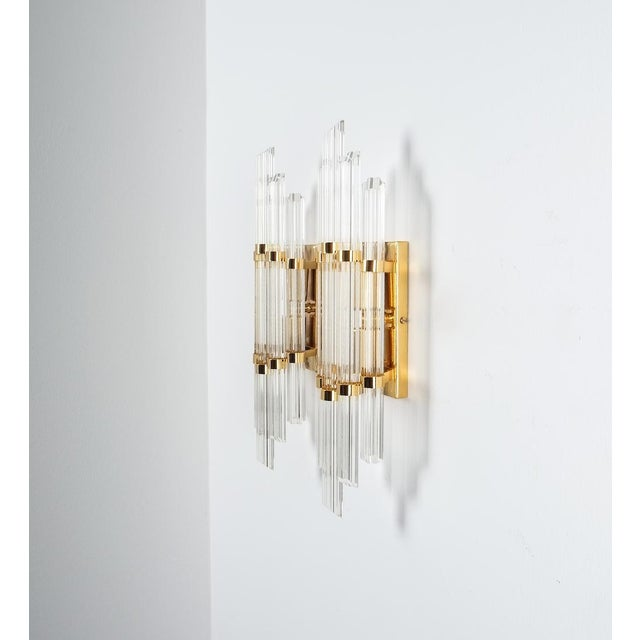 """Large Venini style Murano glass and brass wall lamps sconces, 1970. Elegant pair of 18"""" Murano glass wall lights featuring..."""