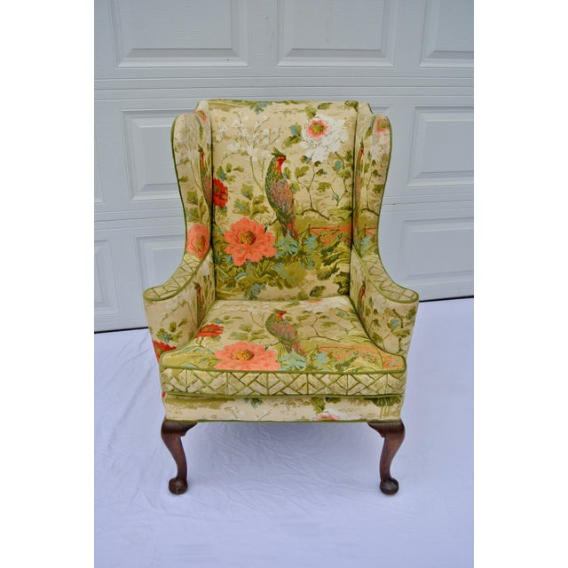 This botanical bird printed wingback chair is rich in green, coral, and blue colors. It will be a statement piece in any...