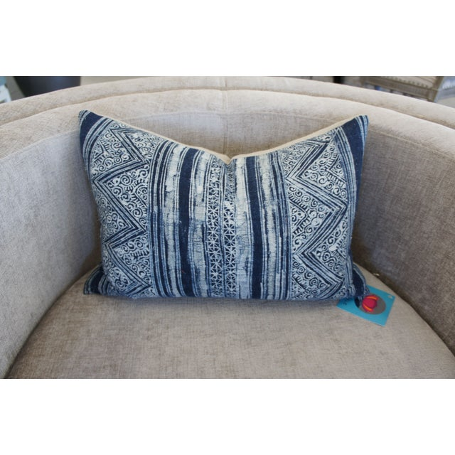 Throw pillows are the cherry on top for your decor. Layer on this fabulous blue and white Batik print pillow for the...