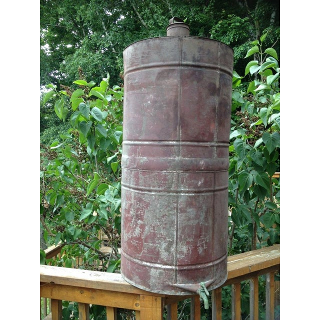 Antique Naphtha barrel with an aged green copper spigot, circa 1880s. This barrel housed a solution called naphtha which...