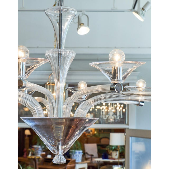 "Pristine Murano chandelier with ten branches capped with chrome and martini glass shaped ""bobêches."" The stems are ridged..."