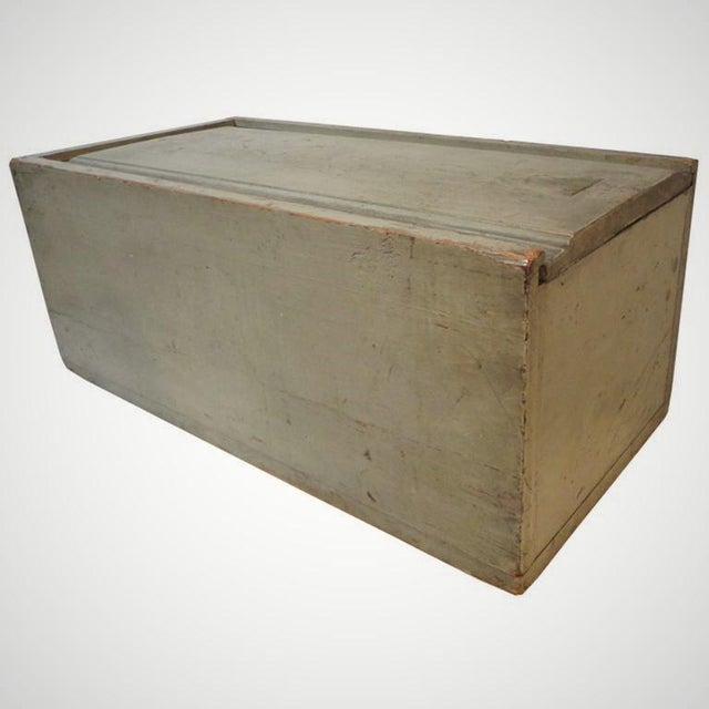 Fantastic 19th century original grey painted handmade large scale candle box from New England. This wonderful slide top...
