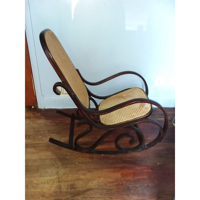 Rocking chair, Sturdy moves with ease. Was purchased from estate sale in Westminster Md. No labels appear to verify Maker....
