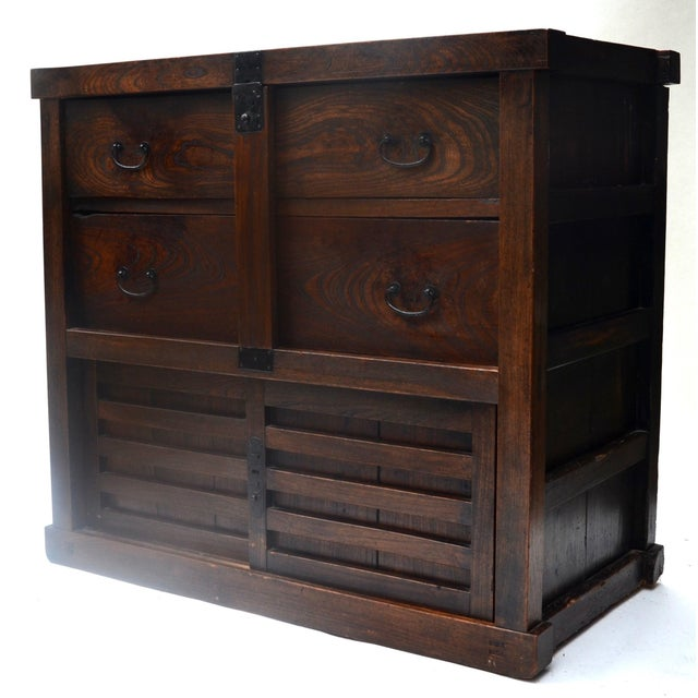 Handsome and rare Edo period, early-mid 1800s keyaki (elm) wood Japanese tansu with removable locking bar over two large...