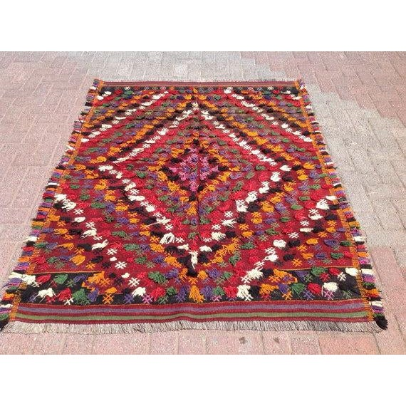 This beautiful, vintage, handwoven kilim is approximately 60 years old. It is handmade. Made of very fine quality hand...