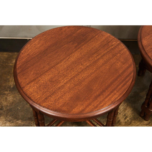 These beautiful walnut side tables are of a good size and shape for multiple uses. The have simple, modern design details...