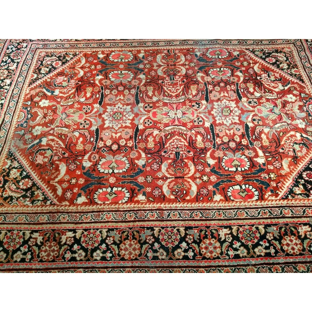 The Mahal or better-known Sultanabad room size rug from the early 1900s has an all-over pattern with large forms...