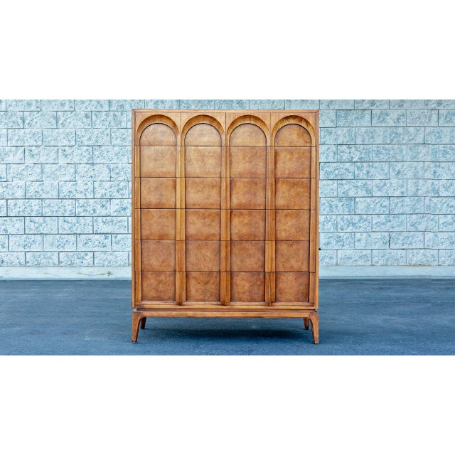 Mid-century modern walnut and burlwood tallboy dresser manufactured by Thomasville. Features sculpted cathedral arches....