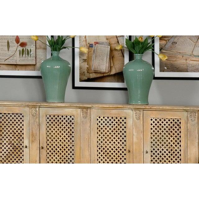 Estimated Retail Price: $375.00. Ceramic Celadon Carved Bamboo -