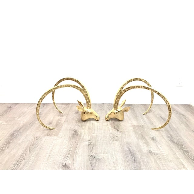Beautiful mid century polished brass ram's head coffee table in excellent vintage condition, the table has to sit on a...
