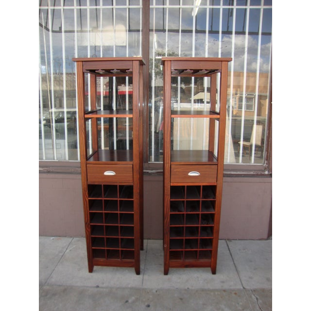 Vintage two wine cabinets with glass holder, a single drawer and a adjusting shelf. Cabinets can holds 18 bottles each...