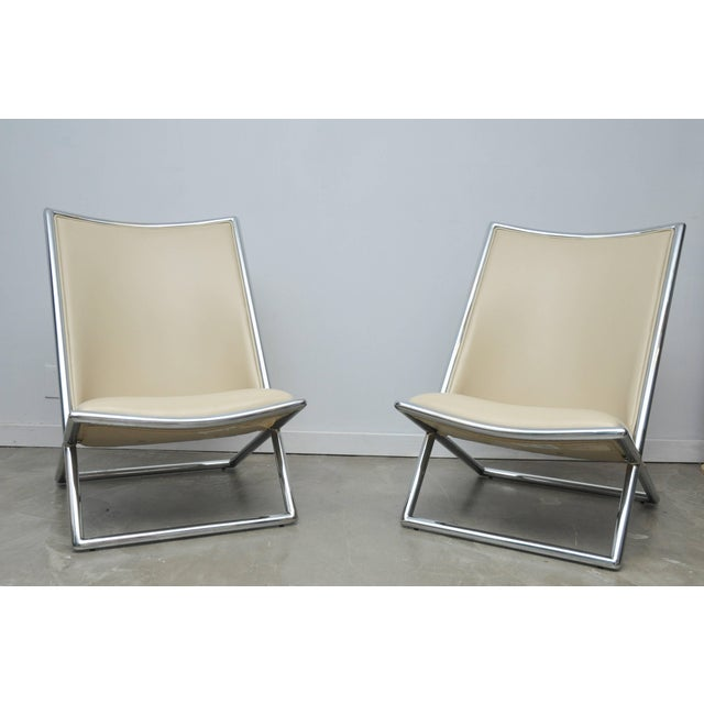 Chrome frame scissor chairs by Ward Bennett with white leather.