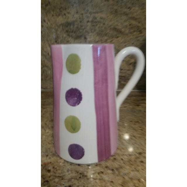 Attractive, hand painted pitcher, imported from Italy. White glazed background with currently popular purple, green and...