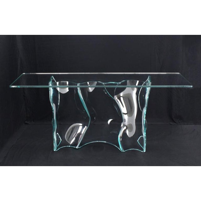 Very unusual studio piece free-form molded glass console table with thick glass top.
