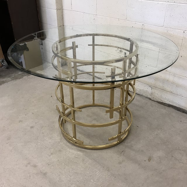 Spectacular brass base on this Mitchell Gold dining table. This table was purchased at an auction of items used on the set...