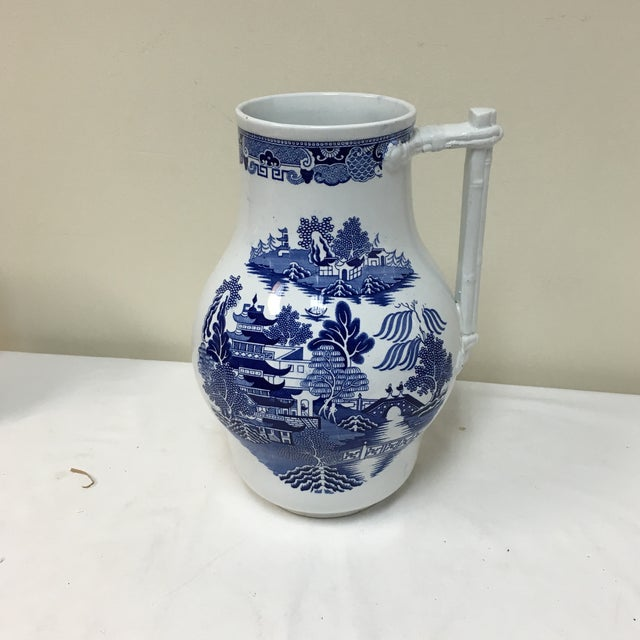 """Unique Blue Willow container probably used as a store counter display with an unusual """"bamboo"""" handle."""