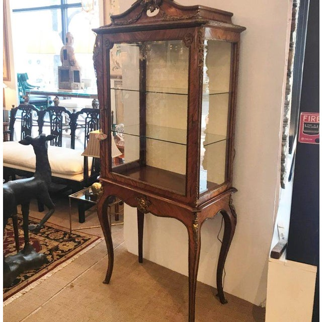 Probably from the 1950's, a beautiful Louis XV 2 piece Bronze Ormolu Mounted Cabinet with 2 glass shelves. Beautifully...