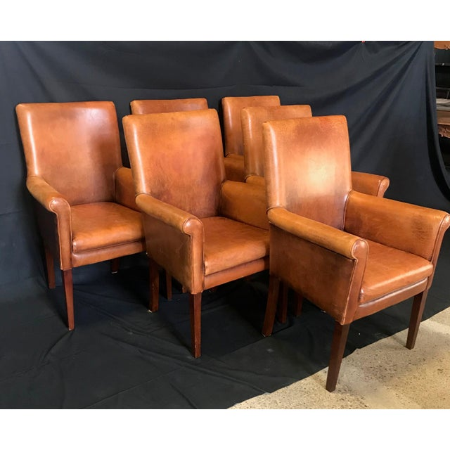 Set of six buttery leather French vintage armchairs with walnut legs. Lucky person who has a table surrounded by these...