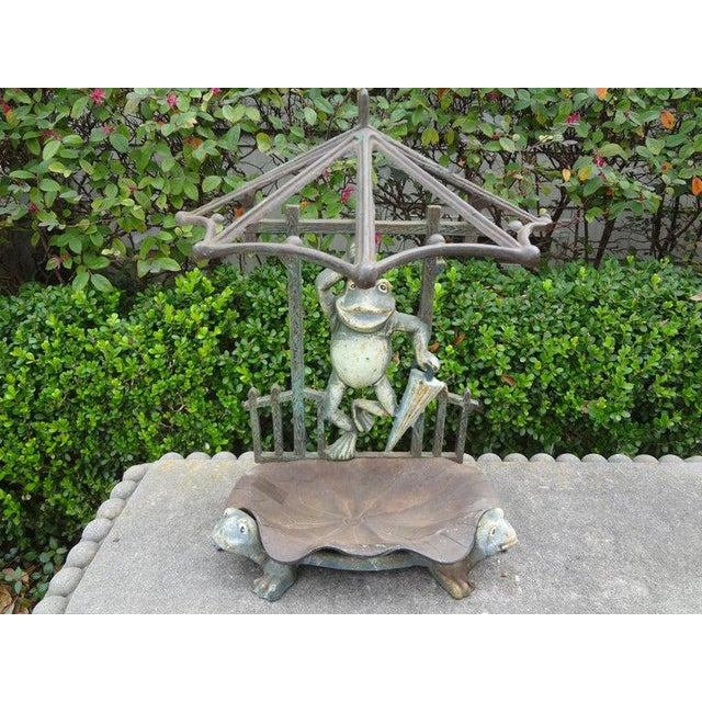 Whimsical French Art Nouveau patinated wrought iron umbrella stand with frogs. This unusual French iron umbrella stand has...
